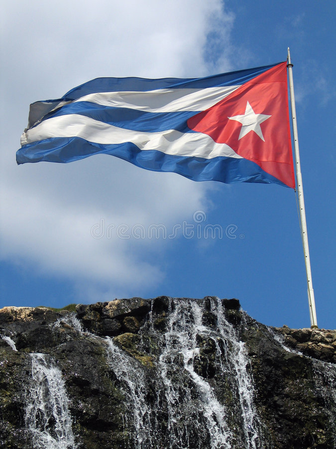 Cuban flag and cascade royalty free stock photos