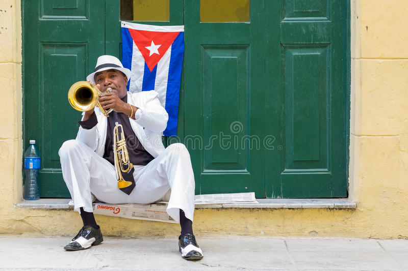 Cuban musician playing the trumpet in Old Havana royalty free stock images