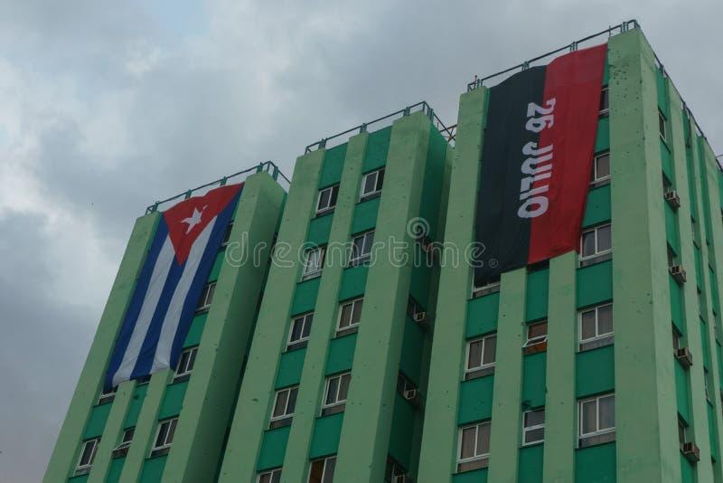 Santa Clara, Cuba, January 5, 2017: Cuban and party flag on building in Santa clara. royalty free stock image