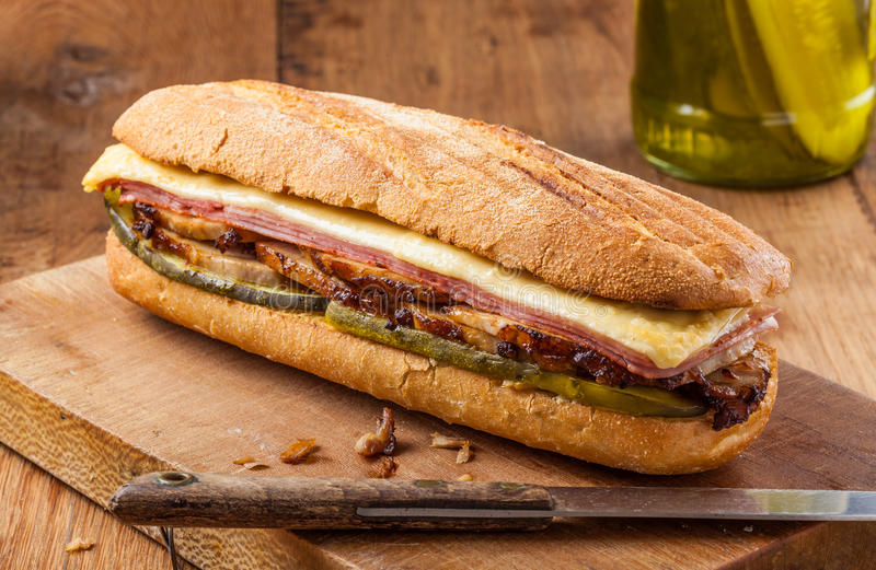 Cuban sandwich. Cubanito. Traditional Cuban Sandwich with Ham, Pork and Cheese royalty free stock images
