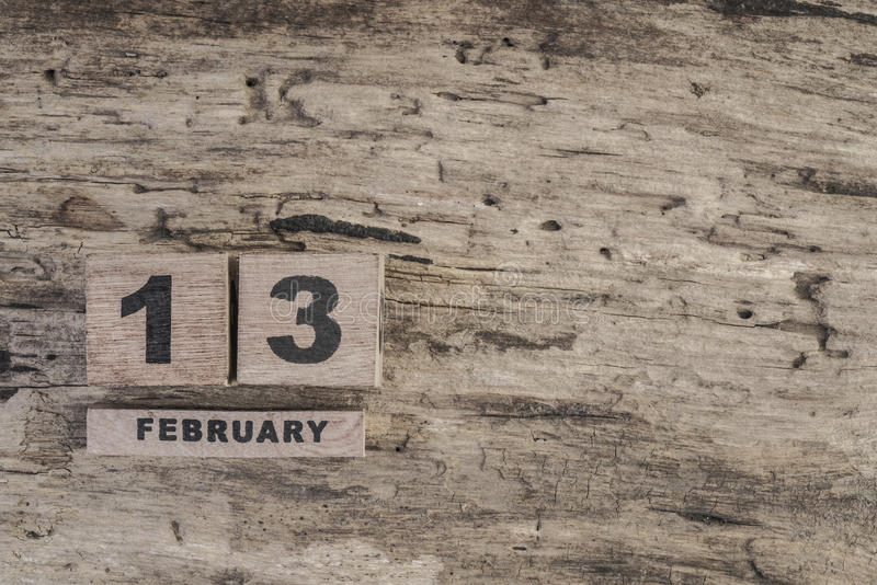 Cube calendar for february on wooden background stock photos
