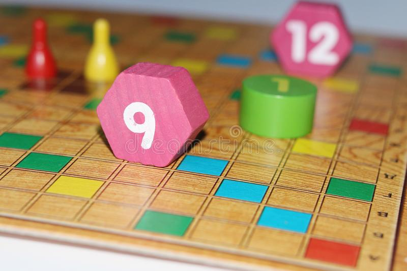 Cube, chips, wooden figures, a bright field for the game stock images
