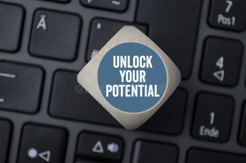 Cube dice unlock your potential royalty free stock photography