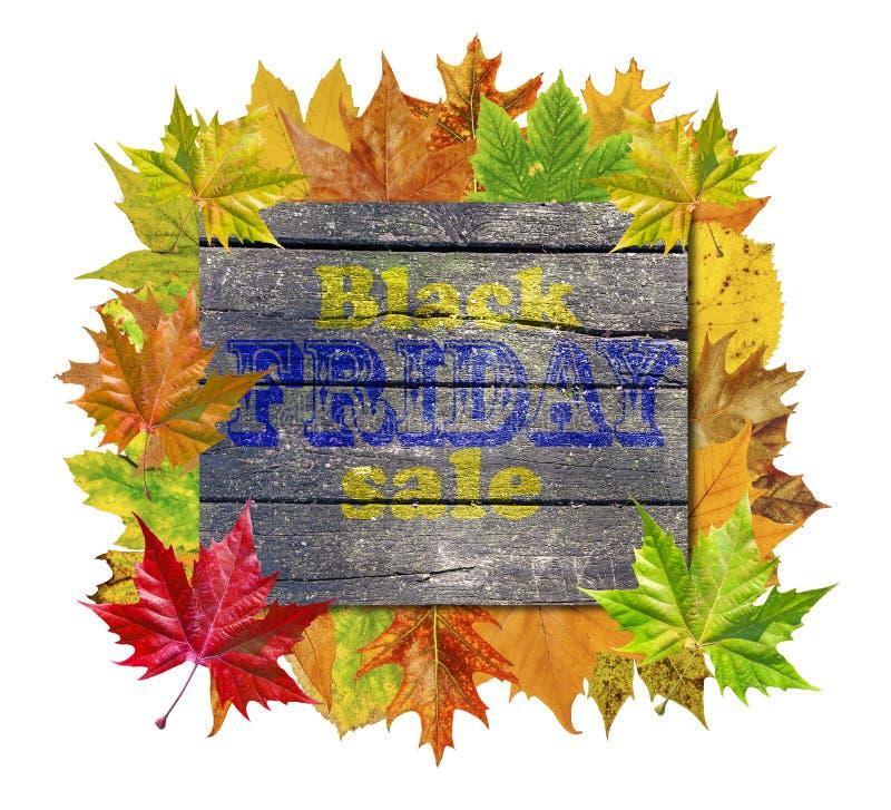 Cube en bois avec des feuilles d'automne autour et la vente de Black Friday de mot images stock