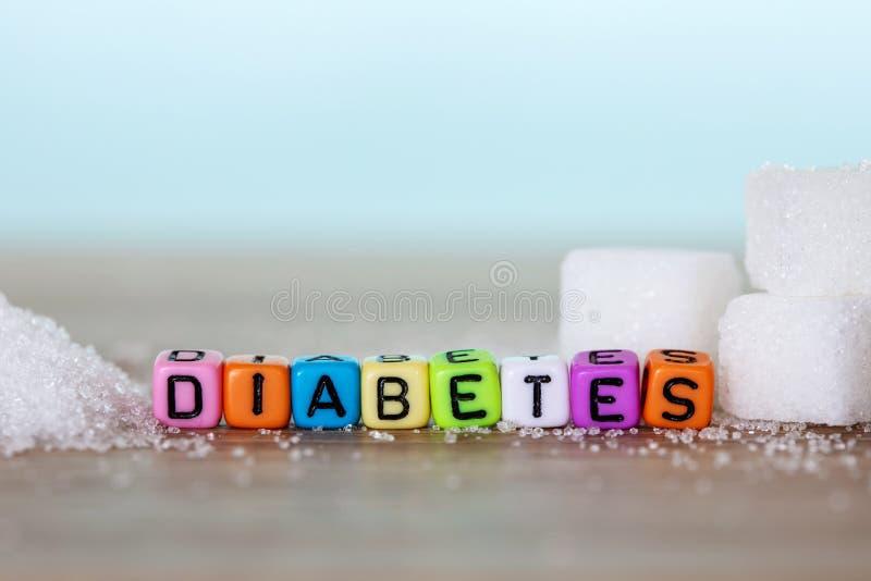 Cube en sucre blanc et bloc coloré d'alphabet de mot de DIABÈTE dessus image stock