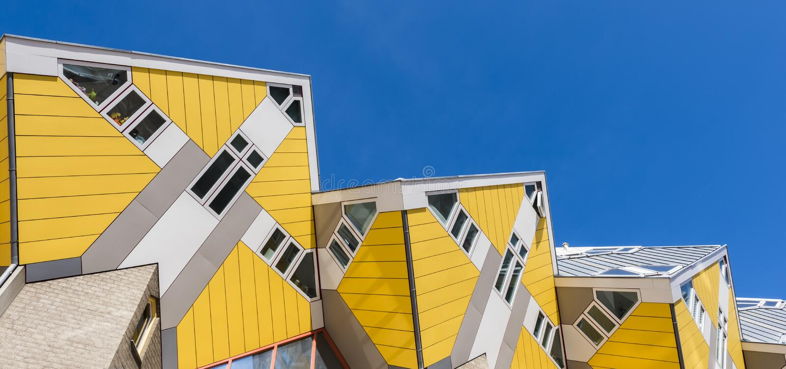 Cube Houses Rotterdam Sky in Line. Rotterdam, The Netherlands - March 24, 2017: Yellow cube houses Rotterdam by architect Piet Blom, 1984 royalty free stock photo