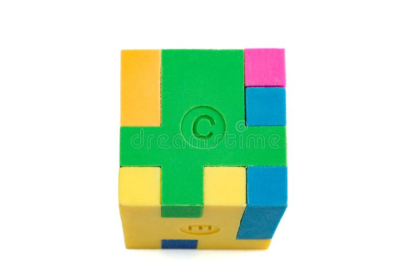 Cube puzzle of multi-colored rubber shapes. Concept of decision making process, creative, logical thinking. Logical tasks royalty free stock photo