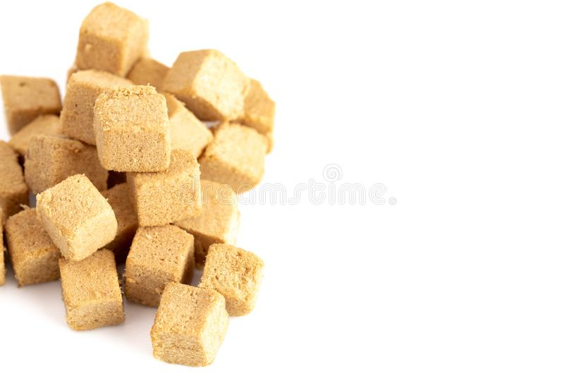 Cube Shaped Doggie Protien Bites on a White Background. Pile of Cube Shaped Doggie Protien Bites on a White Background royalty free stock images