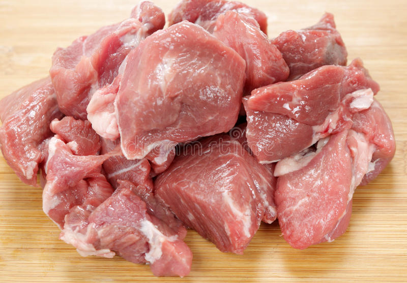 Cubed lamb meat on a board royalty free stock images