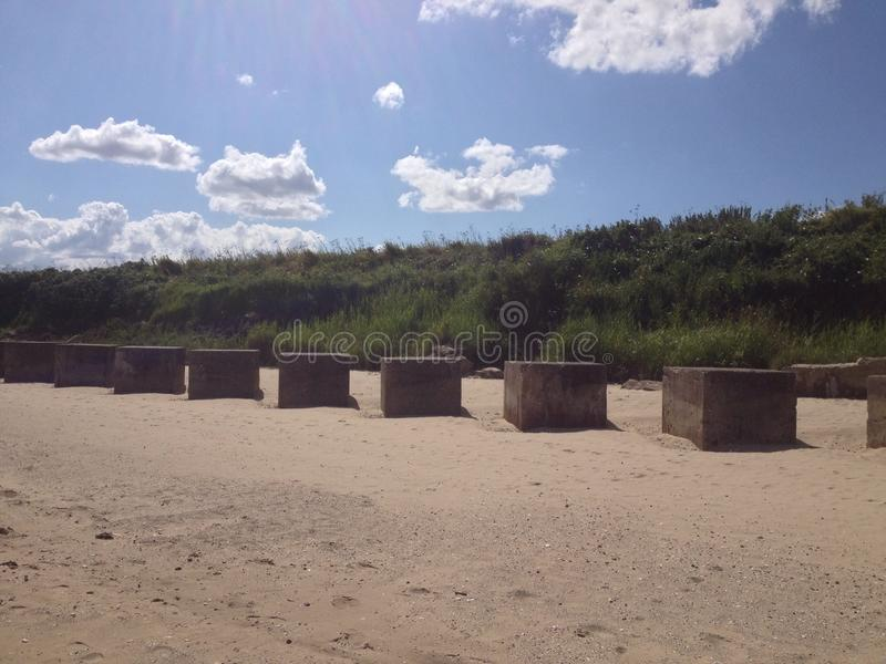 Cubes on a beach royalty free stock photography