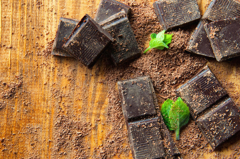Cubes of chocolate and grated chocolate royalty free stock photo