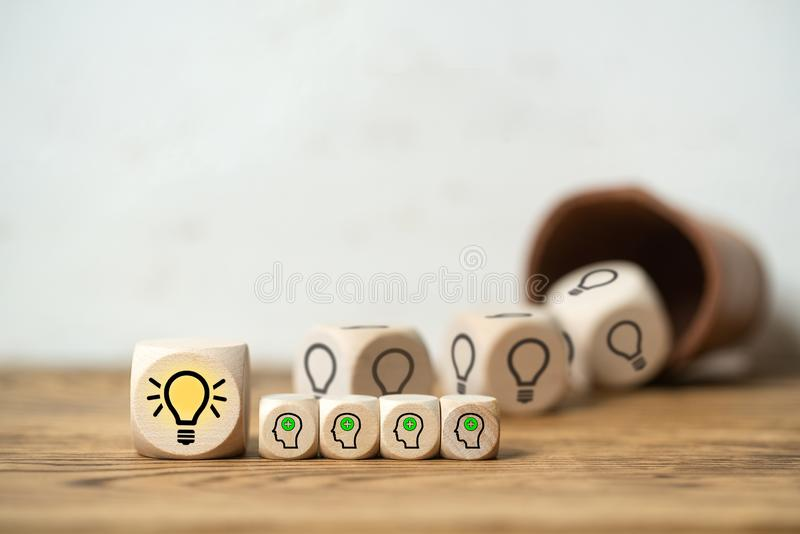 Cubes coming out of dice cup form an idea royalty free stock photos