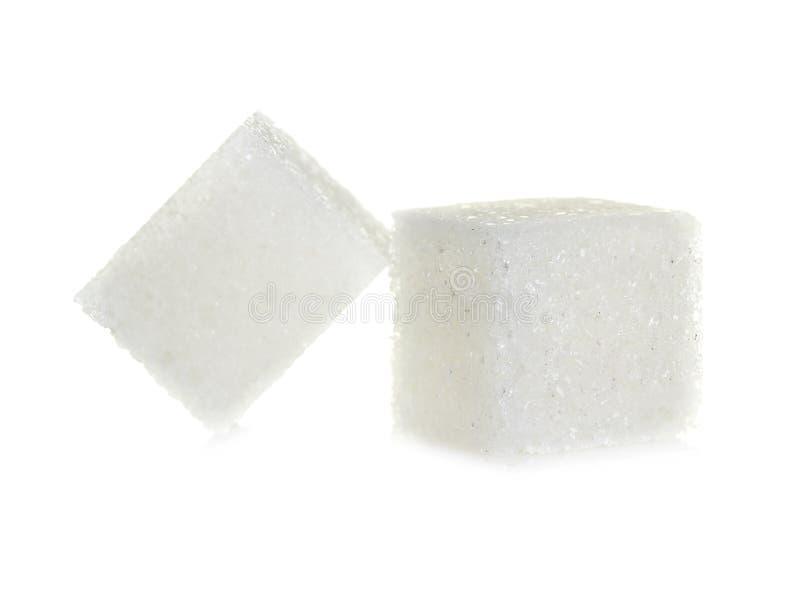 Cubes de sucre d'isolement sur le blanc image stock