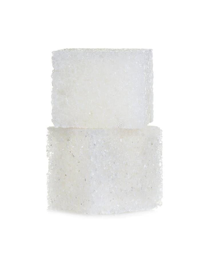 Cubes de sucre d'isolement sur le blanc photographie stock libre de droits