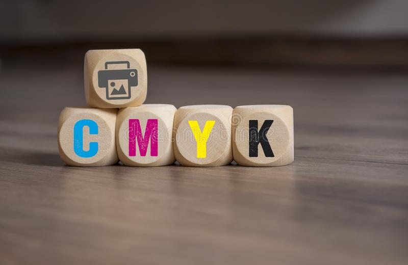 Cubes dice with CMYK. On wooden background stock images