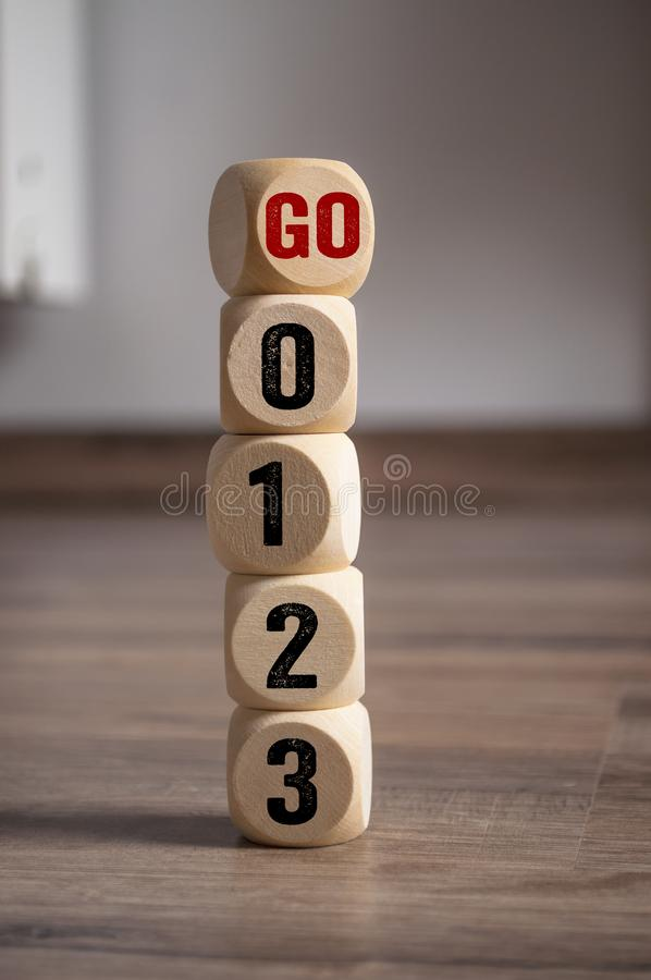 Cubes dice with countdown numbers and go stock images