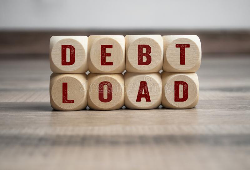 Cubes and dice with debt load. On wooden backround stock images