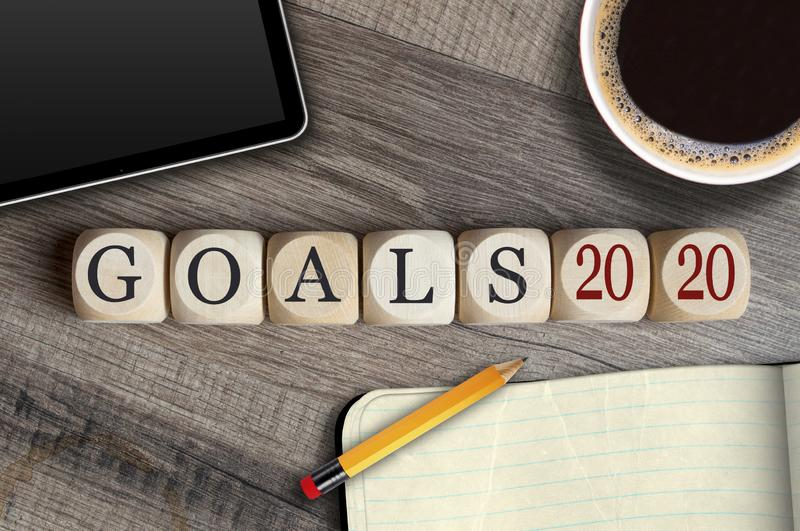 Cubes and dice with goals 2020 on a desk royalty free illustration