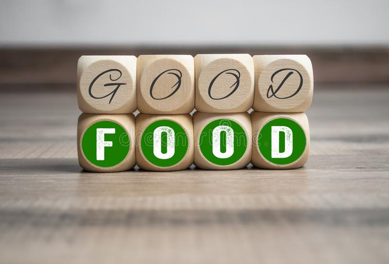 Cubes and dice with good food on wooden background. Cubes and dice with good food royalty free stock photo