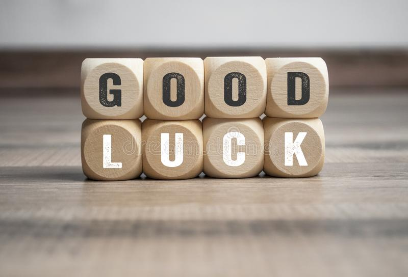 Cubes and dice with good luck. On wooden background stock image