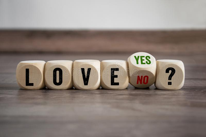 Cubes and dice with love yes or no stock image