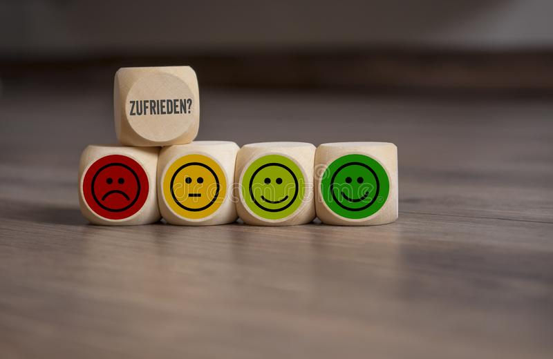 Cubes dice and paper work with rating emoticons. For customer support royalty free stock image