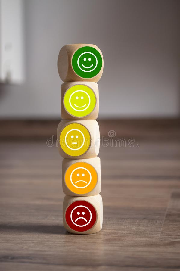 Cubes dice and paper work with rating emoticons for customer support. Cubes dice and paperwork with rating emoticons for customer support stock images