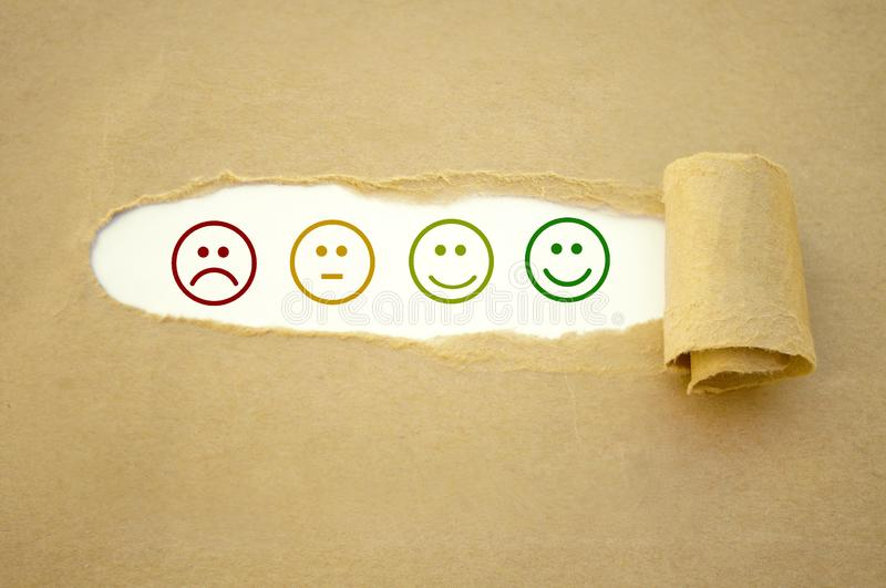Cubes, dice and paper work with rating emoticons. On wooden background stock images