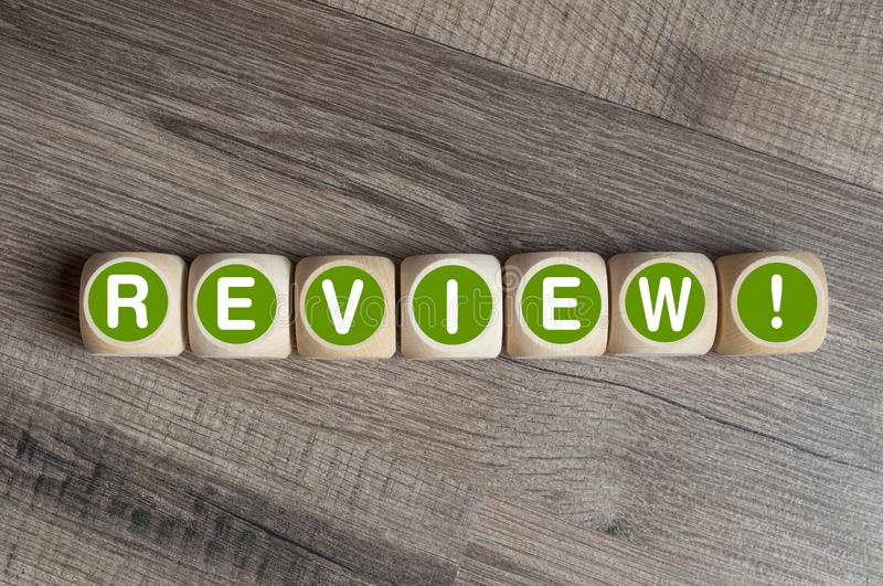 Cubes and dice with review on wooden background royalty free stock photo