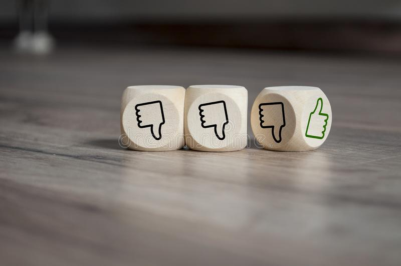 Cubes dice with thumbs up and down stock photo