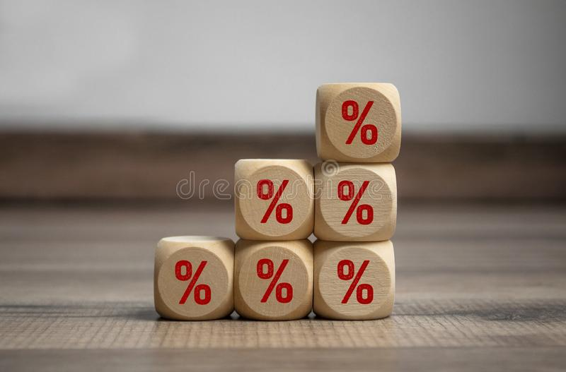 Cubes and dice on wooden background with percentage signs for special offer. Cubes and dice with percentage signs for special offer stock photography