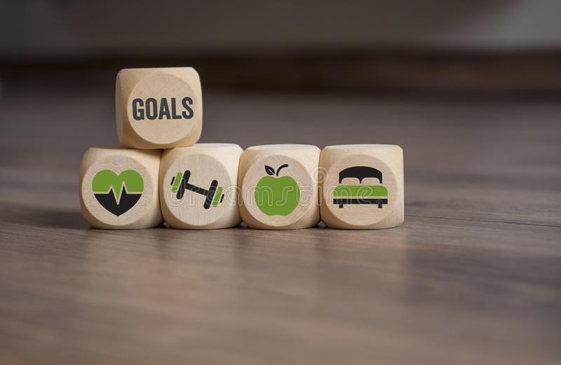 Cubes dice with your goals, health care, fitness training, nutrition and sleep stock photo