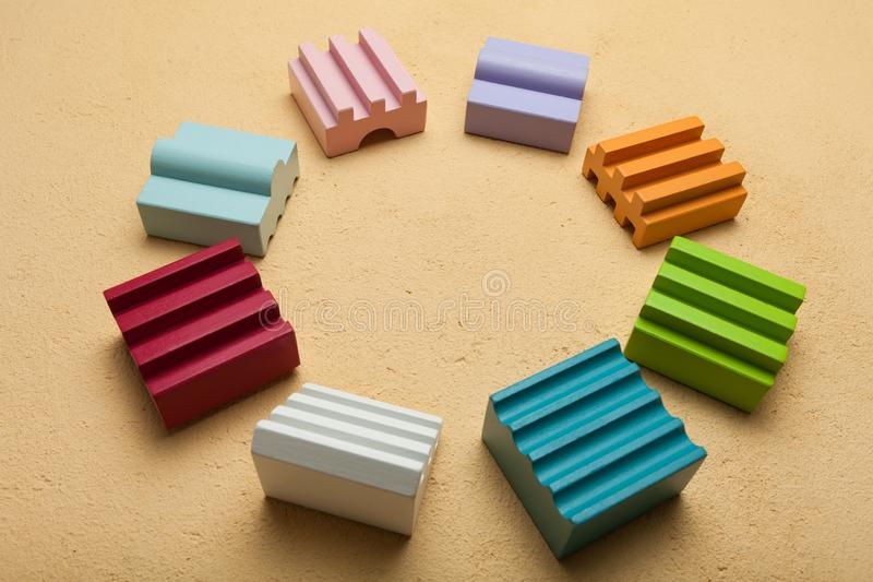 Cubes of different shapes in a circle, team building concept.  royalty free stock photos