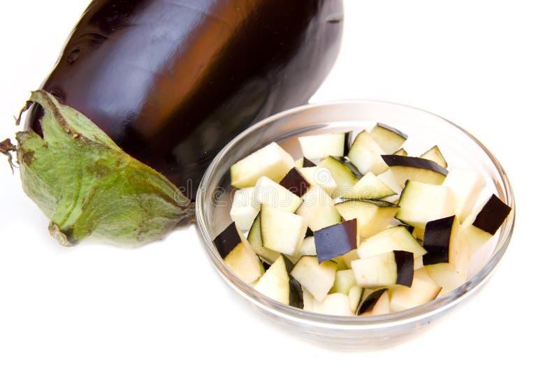 Cubes of eggplant on bowl. On white background royalty free stock photos