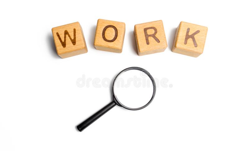 Cubes labeled work with magnifying glass. Concept of job search or workers. hiring specialists and specialized workers. Search royalty free stock image