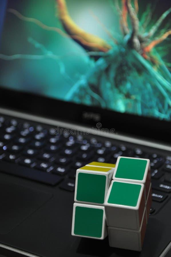 Cubes on laptop keyboard stock image