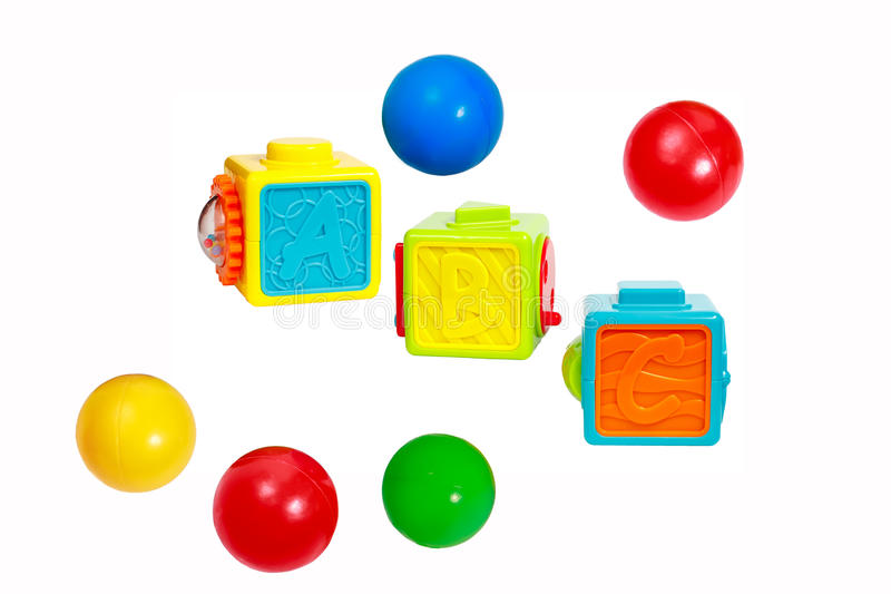 Cubes with letters, interactive pieces and plastic balls royalty free stock photos