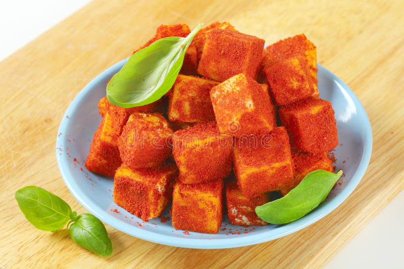 Cubes of spicy cheese stock photography