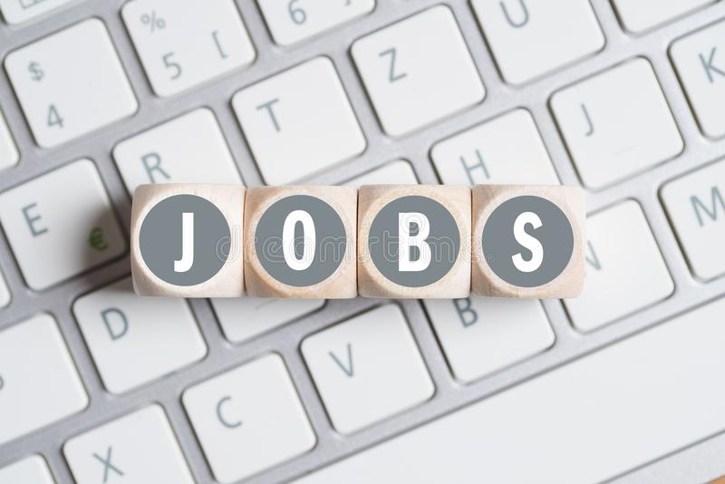 Cubes with the word `JOBS` stock images