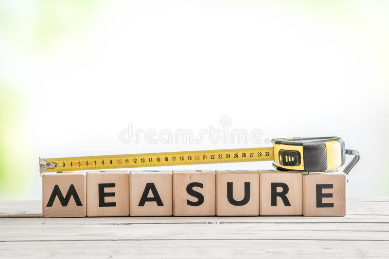 Cubes with the word measure. On a table stock image