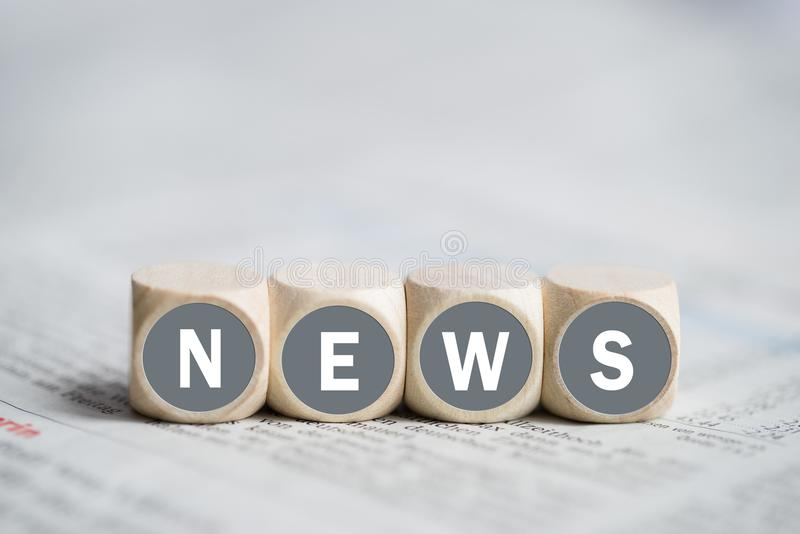 Cubes with the word `news`. On a newspaper stock photography