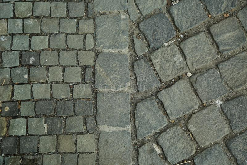 Cubic stone, cobblestone tile pavement. Abstract and decorative sidewalk top view. royalty free stock photography