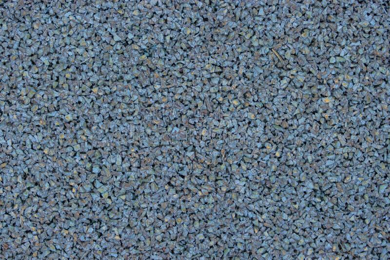 Cubierta de goma azul de una tierra de deportes para los niños Fondo de la textura Suelo de los deportes al aire libre para los j foto de archivo libre de regalías