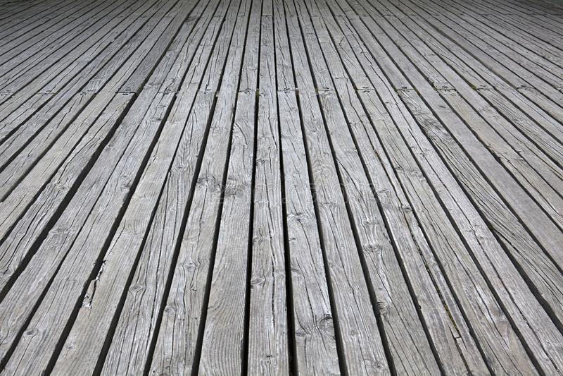 Cubierta de madera gris resistida para el fondo de madera imágenes de archivo libres de regalías