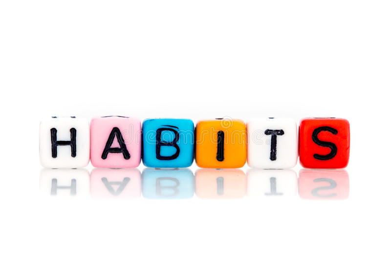 Cubo colorido de la palabra de hábitos imagenes de archivo
