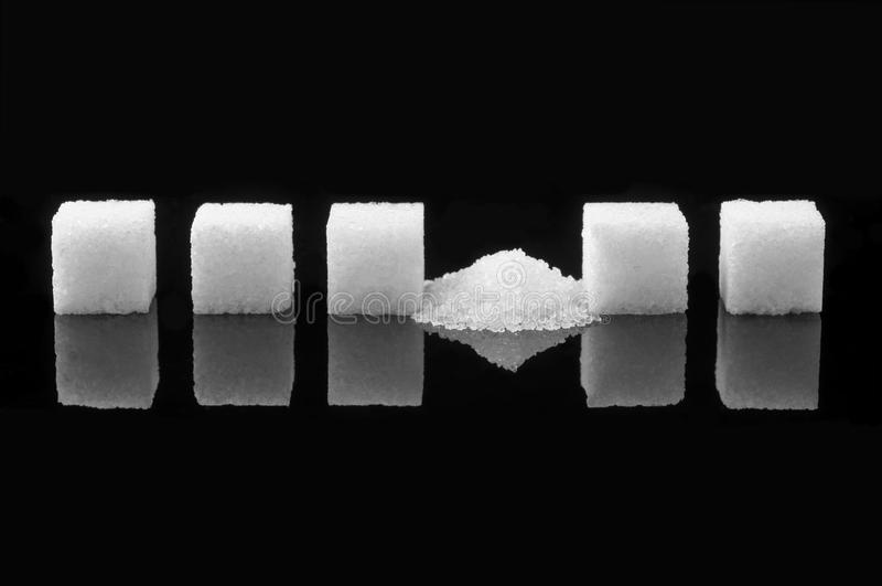 Cubo estrellado del azúcar imagen de archivo