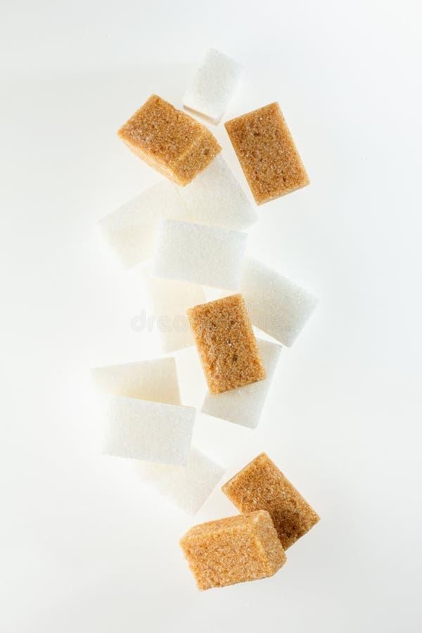 Cubos del azúcar de Brown foto de archivo