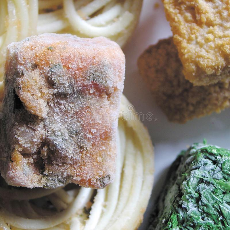 Cubos de la comida congelada foto de archivo libre de regalías