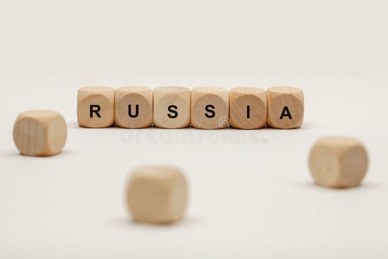 Cubos de madeira com letras a palavra Rússia é indicada, ilustração abstrata fotografia de stock
