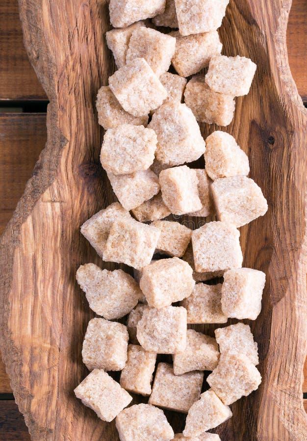 Cubos do açúcar de bastão de Brown fotos de stock royalty free
